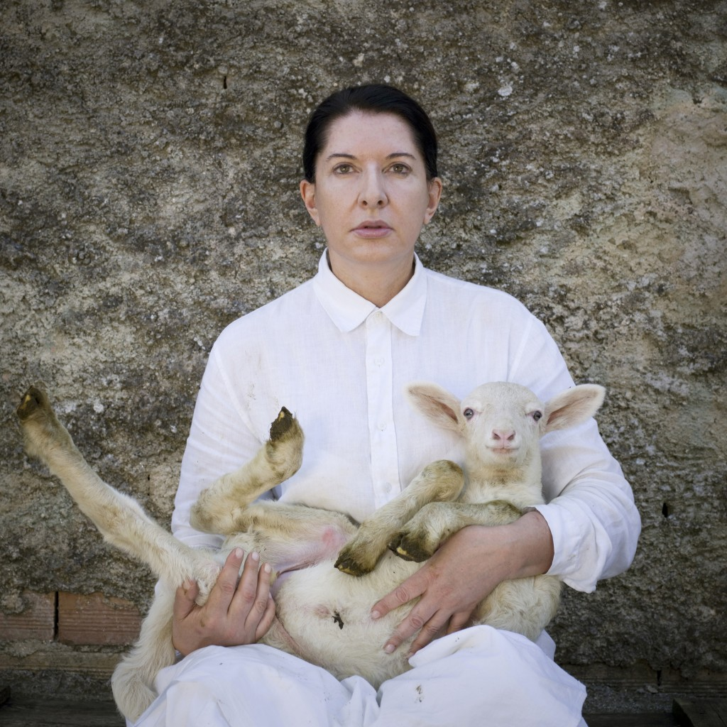 Marina-Abramovic.-Portrait-with-white-lamb.-2010.-Courtesy-the-artist-Marco-Anelli-and-Lisson-Gallery